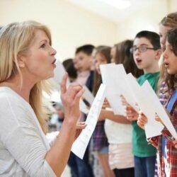 Aws Choir Teacher Coaching Students To Sing