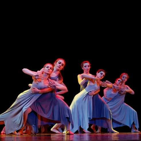Girl Dancers In Blue Dresses Performing On Stage