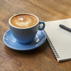 blue mug with latte foam design
